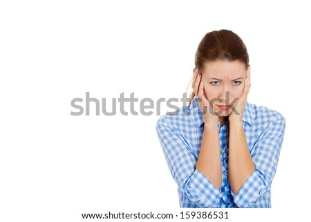 Closeup portrait of a beautiful, young, upset, sad, depressed and worried brunette woman holding her head with both hands, isolated on white background with copy space. Human emotions and expressions - stock photo