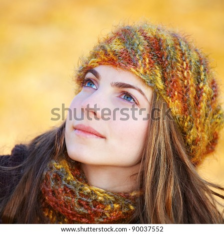 Closeup portrait of a beautiful young woman looking up towards the sky in autumn. - stock photo