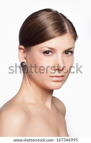Closeup portrait of a beautiful young woman. Skin care concept. Natural look.