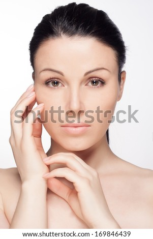 Closeup portrait of a beautiful young woman. Skin care concept. Natural look. Beauty portrait. Spa and health.