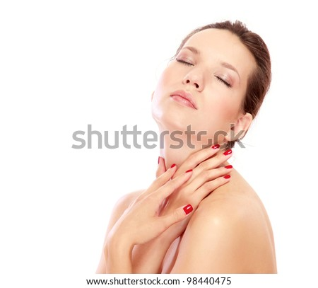 Closeup portrait of a beautiful young woman touching her neck , isolated on white background - stock photo