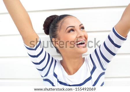 Closeup portrait of a beautiful young woman with carefree expression - stock photo