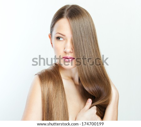 closeup portrait of a beautiful young woman with elegant long shiny hair. - stock photo
