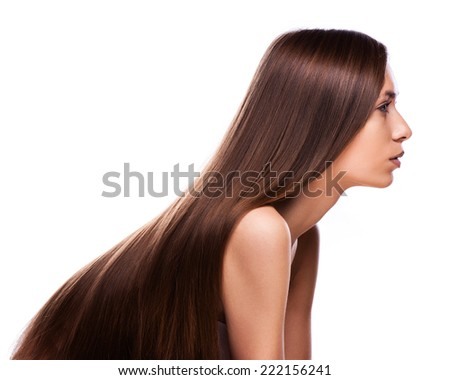 closeup portrait of a beautiful young woman with elegant long shiny hair - stock photo
