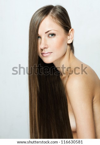 closeup portrait of a beautiful young woman with elegant long shiny hair . brown hair