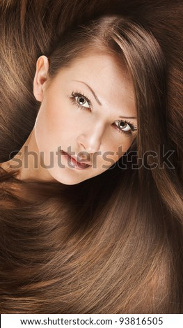 closeup portrait of a beautiful young woman with elegant long shiny hair , concept fashion hairstyle - stock photo