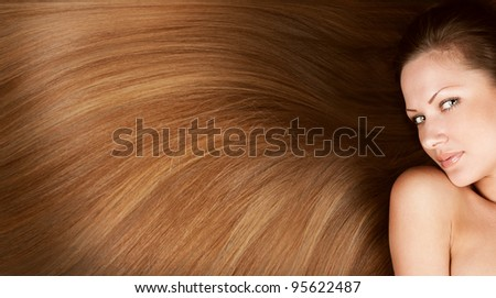 closeup portrait of a beautiful young woman with elegant long shiny hair , concept hairstyle , healthy hair