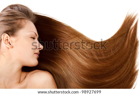 closeup portrait of a beautiful young woman with healthy long brown hair - stock photo