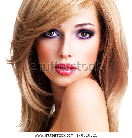 Closeup portrait of a beautiful young woman with long white hairs. Fashion model posing over white background - stock photo