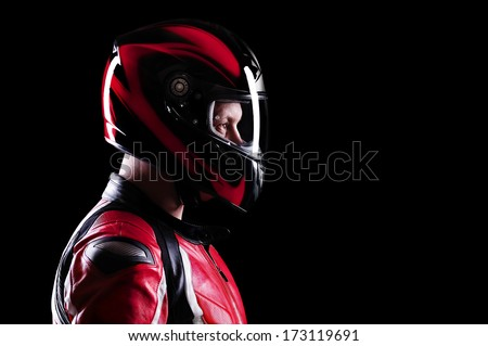 closeup portrait of a biker on black side view - stock photo