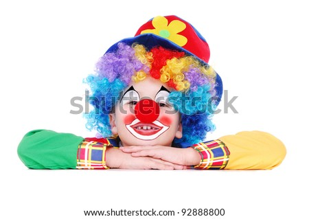 Closeup portrait of a  birthday clown holding the blank board - stock photo
