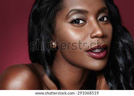 closeup portrait of a black oman with bright lips - stock photo