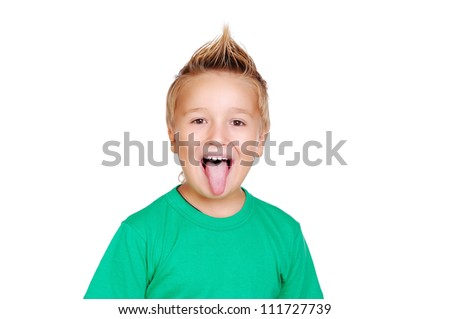 Closeup portrait of a boy showing tongue - stock photo