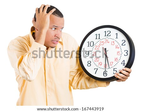 Closeup portrait of a business man, student, leader holding a clock very stressed, pressured by lack of time, running out of time, late for the meeting, isolated on a white background. Emotions - stock photo