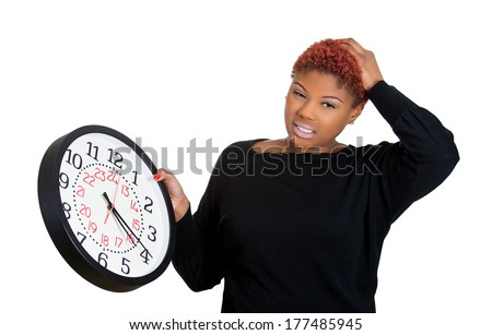 Closeup portrait of a business woman, student, leader holding a clock very stressed, pressured by lack of and running out of time late for a meeting, isolated on a white background. Negative emotions - stock photo