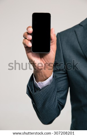 Closeup portrait of a businessman showing blank smartphone screen isolated on a white background - stock photo