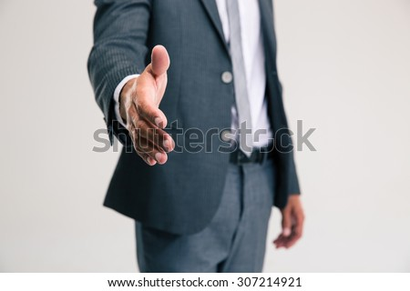Closeup portrait of a businessman stretching hand for handshake isolated on a white background - stock photo