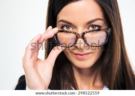 Closeup portrait of a businesswoman holding glasses and looking at camera - stock photo
