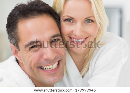 Closeup portrait of a cheerful woman and man in the kitchen at home - stock photo