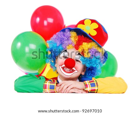 Closeup portrait of a child birthday clown holding the blank board - stock photo