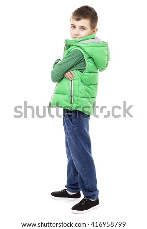 Closeup portrait of a cute little boy with arms folded isolated on white