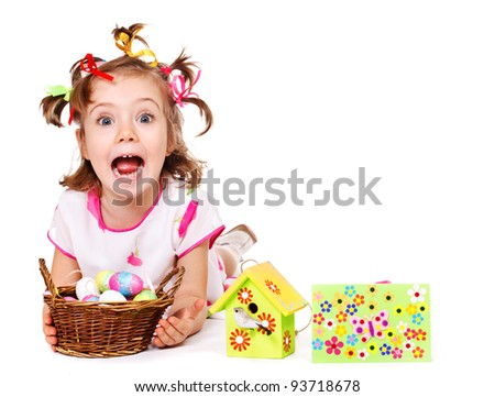 Closeup portrait of a cute little girl with Easter eggs in basket - stock photo