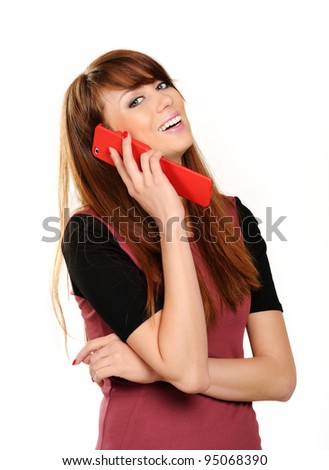 Closeup portrait of a cute young girl talking on mobile phone on a  white background - stock photo