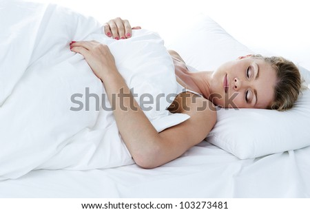Closeup portrait of a cute young woman sleeping on the bed - stock photo