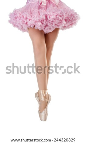 Closeup portrait of a dancer in ballet shoes dancing in Pointe. Isolated. - stock photo
