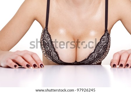 closeup portrait of a female sexy big wet breast - stock photo