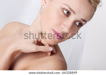 Closeup portrait of a fresh and beautiful young woman on a light background - stock photo