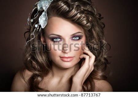 Closeup portrait of a girl on a brown background, European, White, Caucasian, - stock photo