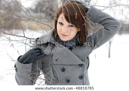 Closeup portrait of a girl walking in winter park - stock photo