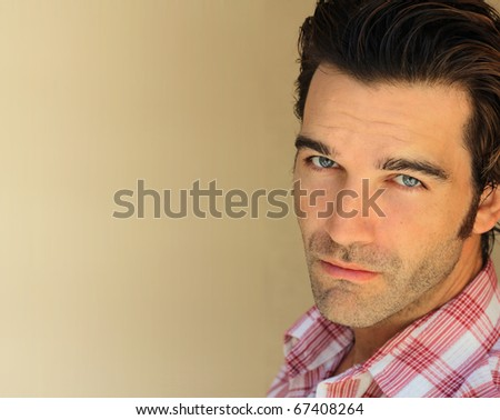 Closeup portrait of a good looking man - stock photo