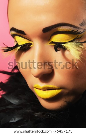 Closeup portrait of a gorgeous woman with bright makeup - stock photo