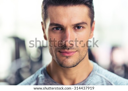 Closeup portrait of a handsome man at gym - stock photo