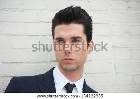 Closeup portrait of a handsome young man in business suit - stock photo