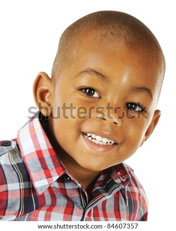 Closeup portrait of a happy African American preschooler on a white background. - stock photo