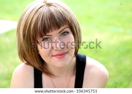 Closeup portrait of a happy blonde woman - stock photo
