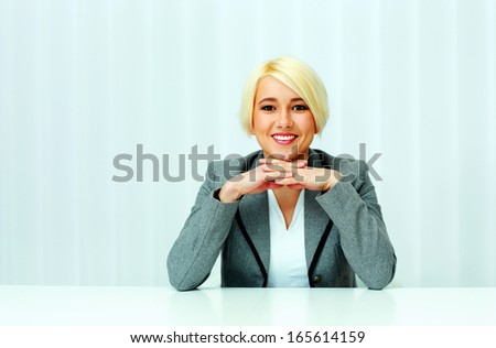 Closeup portrait of a happy businesswoman in casual cloth at office - stock photo