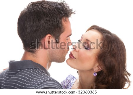 Closeup portrait of a happy couple over white background - stock photo