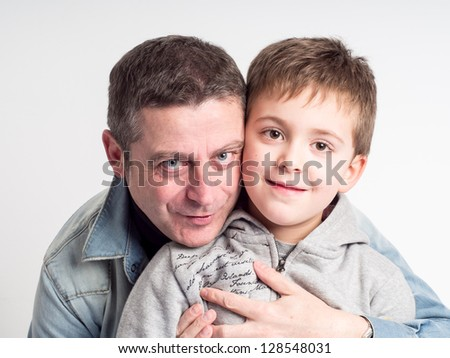 Closeup Portrait of a happy father and son together - stock photo