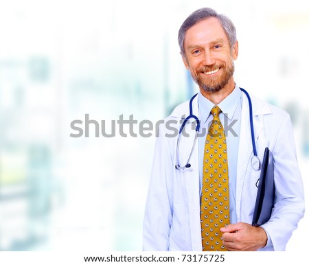 Closeup portrait of a happy senior doctor with stethoscope - stock photo