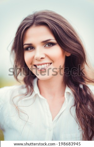 Closeup portrait of a happy smiling beautiful young woman - stock photo