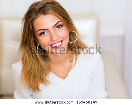 Closeup portrait of a happy smiling woman with copyspace - stock photo