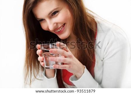 Closeup portrait of a happy  woman holding a glass of water - stock photo