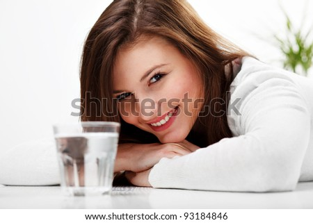 Closeup portrait of a happy  woman with glass of water - stock photo