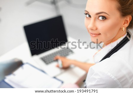 Closeup portrait of a happy young doctor  - stock photo
