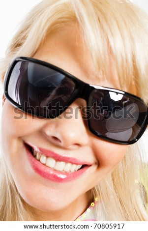 Closeup portrait of a happy young female fashion model in sunglasses - stock photo