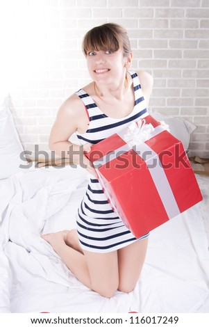 Closeup portrait of a happy young girl relaxing on the bed. - stock photo